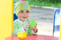 Little kid in the playground. Royalty Free Stock Image