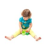 Little kid playing alone with nesting blocks Stock Photography