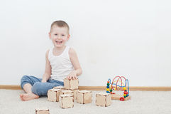 Little kid is playing with blocks Stock Photography
