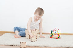 Little kid is playing with blocks Royalty Free Stock Photo