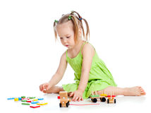 Little kid playing with colourful toys Royalty Free Stock Images
