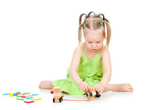 Little kid playing with colourful toys Stock Photo