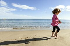 Free Little Kid Playing In The Beach With A Big Shadow Royalty Free Stock Photography - 177134777