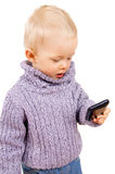 A little kid playing with a mobile phone Royalty Free Stock Image