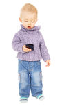 A little kid playing with a mobile phone Royalty Free Stock Photo