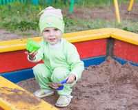 Little kid playing in a sandbox Royalty Free Stock Photo