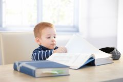 Little kid playing schoolboy at home Stock Photo