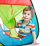 Little kid playing in a tent Stock Photo