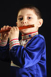 Little kid playing wooden flute Stock Images