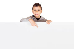 Little kid pointing to a blank banner Stock Images