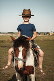 Little kid with pony Royalty Free Stock Photo