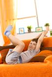 Little kid posing on sofa Royalty Free Stock Photography