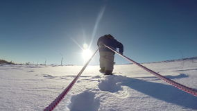 Little kid pulling sled to the slope top stock video footage