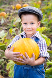 Little kid with pumpkin in hands Royalty Free Stock Photos