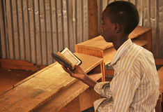 Little kid read holy Qoran Stock Image