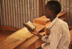 Little kid read holy Qoran Stock Image