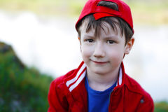 Little kid in red cap Stock Photography