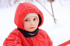 Little kid in red jacket Stock Image