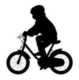 Little kid ride a bike. Vector illustration of little kid ride a bike silhouette Stock Photography