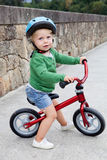 Little kid riding his bike down Stock Photo