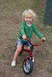 Little kid riding his bike down royalty free stock images