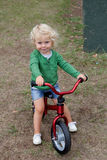 Little kid riding his bike down royalty free stock image