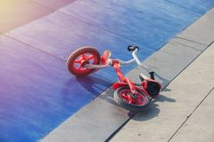 Little kid`s bicycle down on a skateboard ramp park royalty free stock images