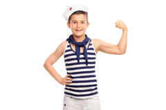 Little kid in a sailor outfit flexing his bicep Royalty Free Stock Image