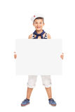 Little kid in sailor outfit holding a big blank banner Stock Photography
