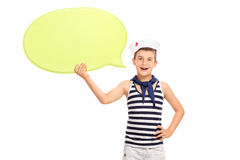 Little kid in a sailor outfit holding a speech bubble Royalty Free Stock Photo