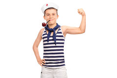 Little kid in sailor outfit showing his bicep Stock Images