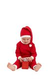 Little kid in santa costume with present Royalty Free Stock Images