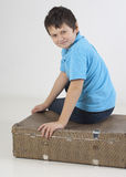 Little kid sit on a suitcase royalty free stock photography