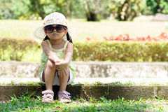 Little kid sitting in the park Royalty Free Stock Photos