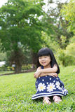 Little kid sitting in the park Royalty Free Stock Photo