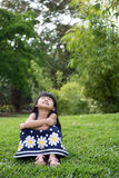 Little kid sitting in the park Stock Image