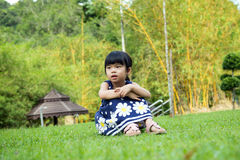 Little kid sitting in the park Royalty Free Stock Image