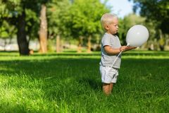 Sweet little child looking at the balloon royalty free stock photo