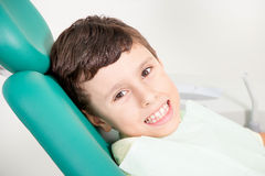 Little kid smiling at dental clinic stock images