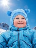 Little kid on snow day Royalty Free Stock Image