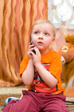 Little kid speaks over cell phone Stock Photography
