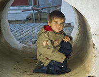 Little kid in a stone tube Royalty Free Stock Photography