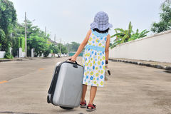A little kid with a suitcase escape from house Royalty Free Stock Photography