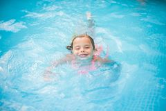 Swimming in pool. stock images