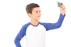 Little kid taking a selfie with cell phone Stock Photo