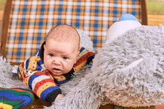 Little kid with teddy bear. Royalty Free Stock Images