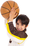 Little kid while throwing the ball royalty free stock images
