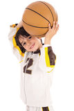 Little kid while throwing the basketball Stock Photos