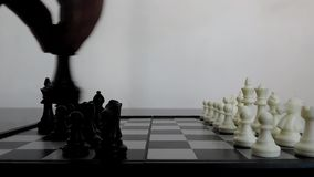 A child trying to play chess stock video footage