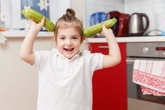 Little kid with two zucchini Stock Photo